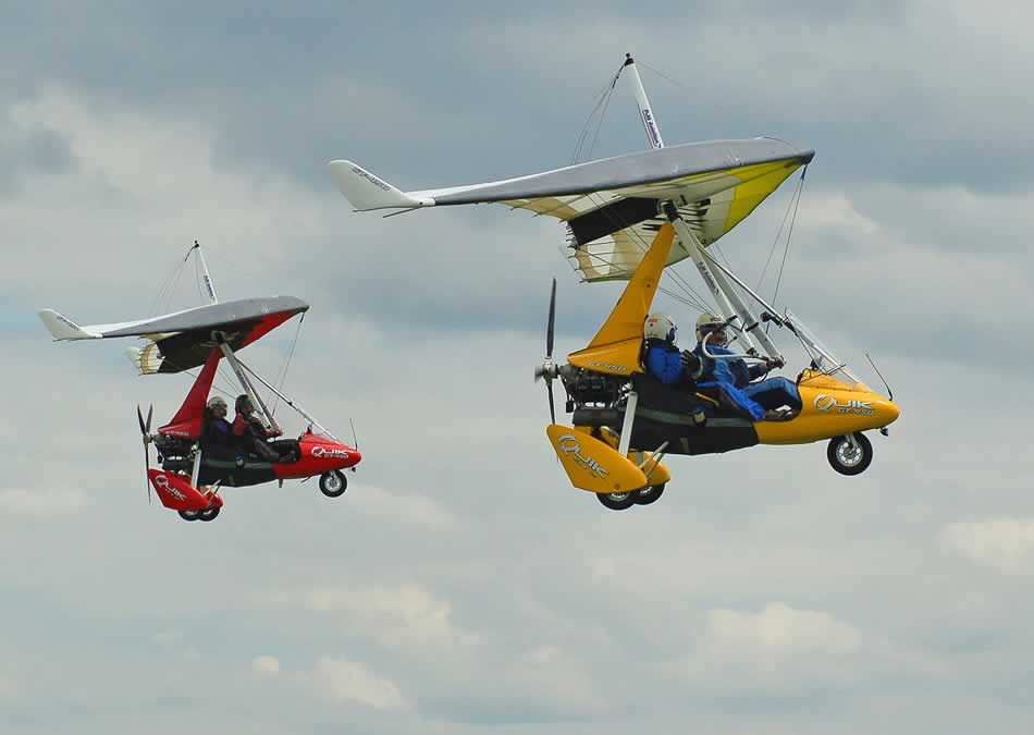 Two Quik GT450 microlights in formation