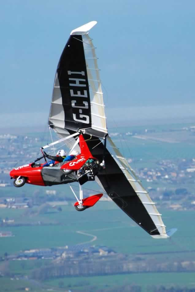 Quik GT450 microlight performing a steep wing-over