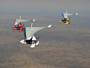 Three microlights flying in formation